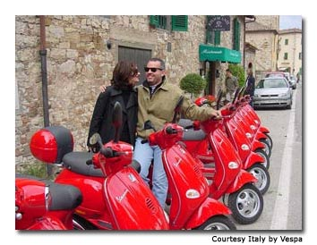 Two Italy by Vespa guests enjoy a quiet moment before heading out for a another perfect day of riding in Tuscany.