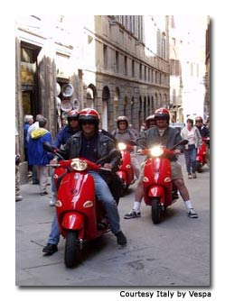 "Manufacturers had never before produced a red Vespa in Italy, so all heads turned for the daily ""scootercade."""