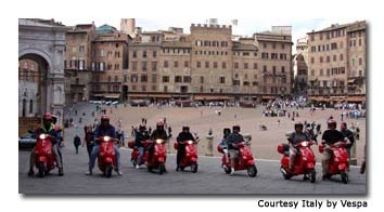 Riders cross the famous Piazza del Campo in Siena, site of the city's annual bareback horse race.