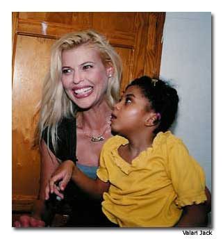 Susie Krabacher with a child in Haiti