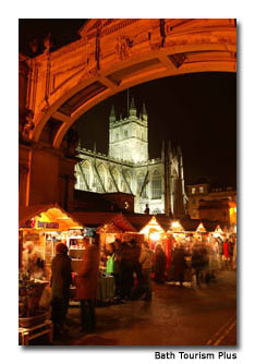 Retailers at the Bath Christmas Market draw visitors with festive wares.
