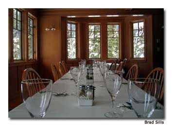 Tranquil winterscapes grace windows in the lodge dining room.