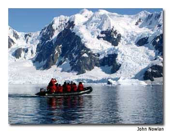 Cruise ship passengers explore the Antarctic waters via a Zodiac.