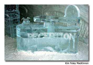 An intricate reception desk made entirely of ice stands in the front