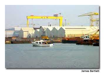 The Joyce Too tour boat motors past the Harland and Wolff shipyard, where the Titanic was built.