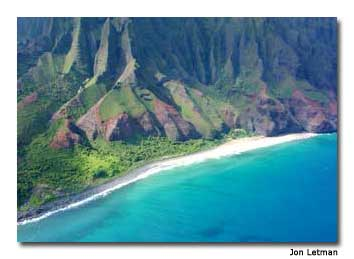 The famed Na Pali Coast extends 14 miles along the northwest shore of Kaua'i. One of the geologic highlights of Hawai'i, Na Pali can only be seen by boat, helicopter or on foot trails.