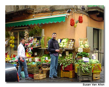 A corner market in Naples' Spanish Quarter overflows with produce.