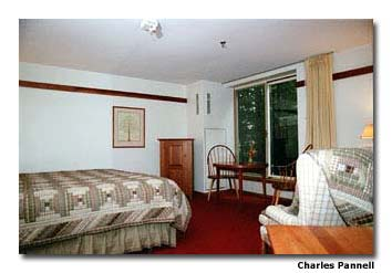 Room 121 at The Inn at Honey Run has excellent pathway access and a great view of the adjacent woods.
