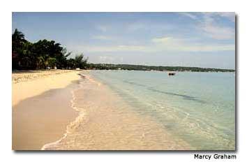 Warm Caribbean waters caress Jamaica's Negril Beach.