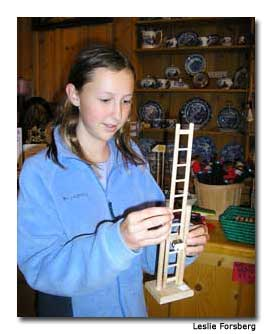 Kirsten was transfixed by the simple pleasures of a tumbling ladder toy.