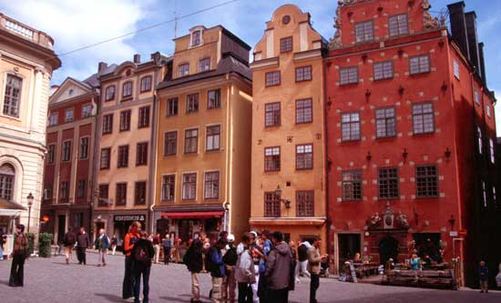 Locals enjoy a summer evening in Gamla Stan in Stockholm.
