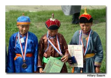 Skilled child jockeys are rewarded for their accomplishments in the horse races.