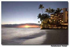 The rolling waves of the Pacific Ocean border the Halekulani Hotel in Oahu, Hawaii.