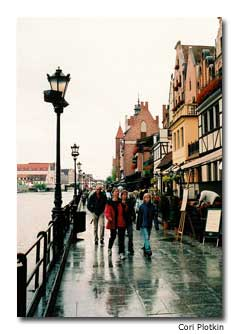 Crowds of people walk theGdansk waterfront in search ofthe perfect memento.