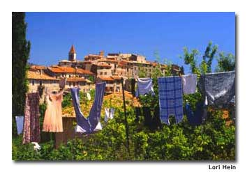 Laundry flaps in the breeze in Gorbio, set high on a rocky precipice.