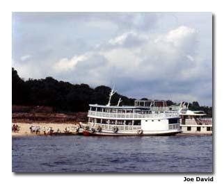 Amazon River boats allow visitors close-up views of the jungle. Photo by Joe David