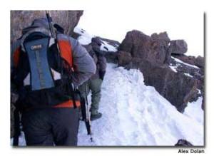 Hikers close in on Uhuru Peak, the summit of Kilimanjario.
