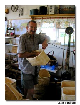 Björn Majors uses traditional tools and methods to craft his classic wood-strip baskets.