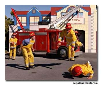 "Kids can help put out a ""fire"" in a burning building in Legoland's Fun Town Fire Academy."