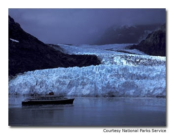 A cruiseship stations itself in front of the Margerie Glacier on a typical rainy day.