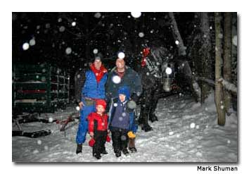 Some guests pose for a picture in the snow.