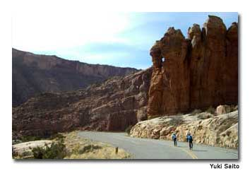 Cyclists sail down the hills at Arches, one of two national parks within cycling distance of Moab.