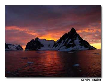 In Lemaire Channel, ice-covered peaks rise from the surface of the frigid water.