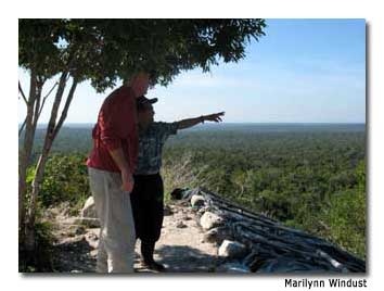 The guide, José, points to the remains of the metropolis of El Mirador.