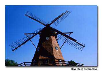 Visitors enjoy windmills, canals and rides in the amusement park.