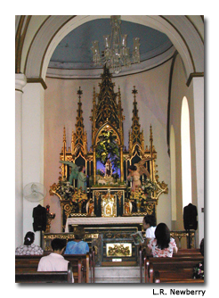 Visitors enjoy the serenity of the chapel in Catedral Nuestra Señora de la Guadalupe.