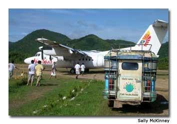 Passengers board the Asian Spirit on Palawan.