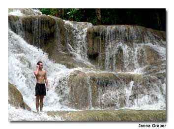 A traveler enjoys the waterfalls at Dunn's River Falls & Park.