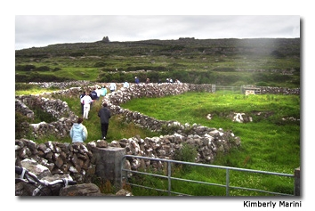 Parallel stone walls run up the mountain and serve as a path.
