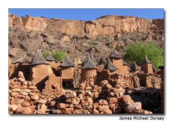Dogon built their villages on slopes, creating elaborate mud houses with thatched roofs that, from a distance, blend perfectly with the land.