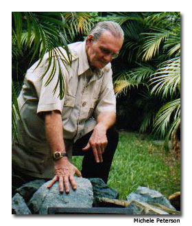 From his workshop in Antigua, Guatemala, geologist Jay Ridinger demonstrates the beauty of a boulder of Olmec Blue Jade before it is cut into gemstones.