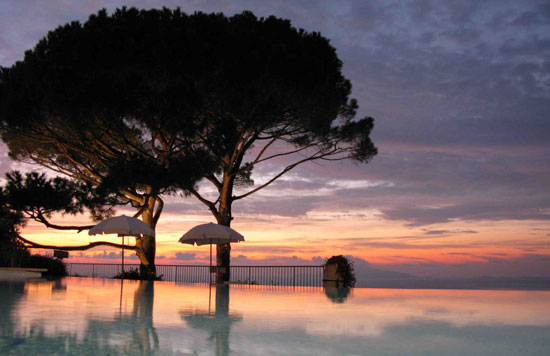The Hotel Caesar Augustus in Anacapri is one of the island's best places to view the sunset. Cocktails in hand, guests gather to gawk at the flaming spectacle reflected in the mirror-like surface of the infinity edge pool. Photo by Amy Laughinghouse