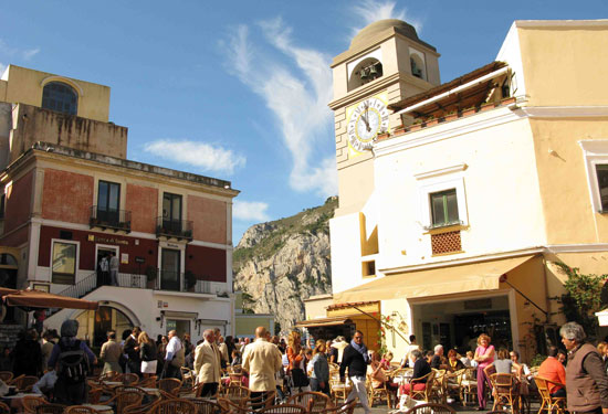 Piazza Umberto I, popularly known as the Piazzetta, is the place to see and be seen in Capri, as folks gather day and night for a coffee or a cocktail.