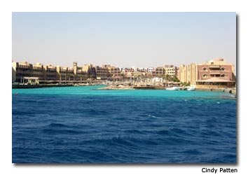 "Red Sea waters lap against the sandy hotel strip. Not yet an ""it"" tourist destination, Hurghada has been under an explosion of construction for the past two decades."