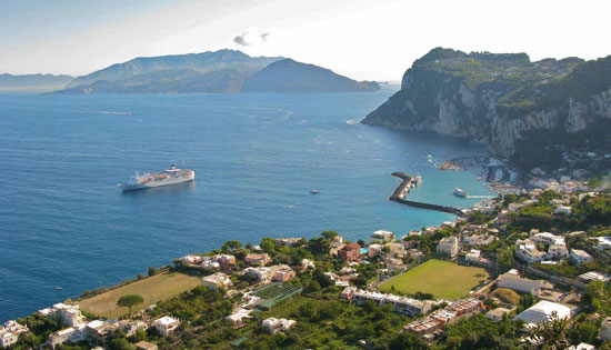 White cliffs provide a dramatic backdrop for the port of Marina Grande in Capri. Photo by Amy Laughinghouse
