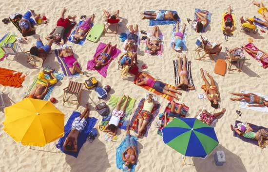 Enjoying the sun at Bondi Beach in Australia. Photo by Tourism Australia