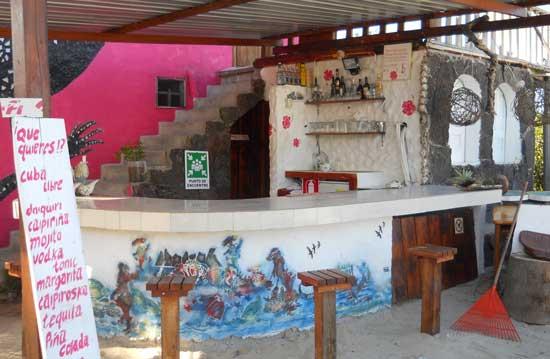 Relaxing at the bar at Caleta Iguana Hotel on Isabela Island, Galapagos.