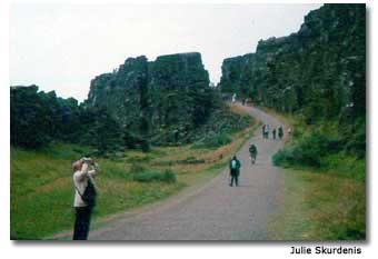Visitors walk along the high cliff at Thingvellir, the historical site of Iceland's 9th century Parliament.