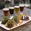 Enjoying duck tacos along with a sampling of beer at Escondido Stone Brewery. Photo by San Diego CVB.