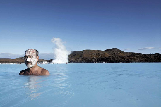 Guests slather themselves in silica mud and relax in the geothermal waters of the Blue Lagoon.