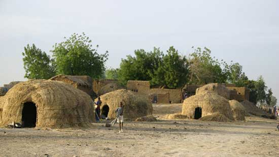 Grass fulani huts in Africa. Photo by James Dorsey