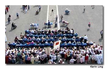 At mass, stretchers pull up in front of wheelchairs.
