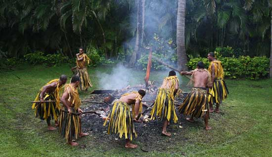 Preparing for the firewalking ritual in Fiji. Photo by Richard Varr