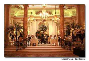 Intricate chandeliers and linen-draped tables set a mood of elegance in the Ritz tea room