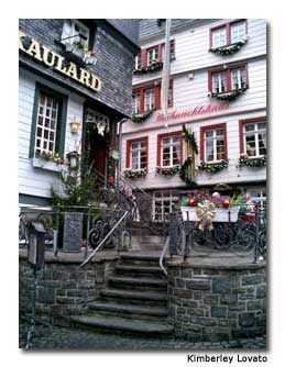 Monschau's buildings and square are decorated for the season.