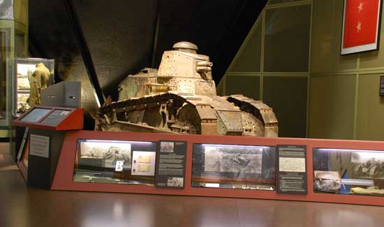 damaged war machine, officially known as a Renault FT-17 tank and commonly used by American forces during World War I, rests in retirement on a museum floor, still nursing its permanent wound in the shape of a gaping hole.